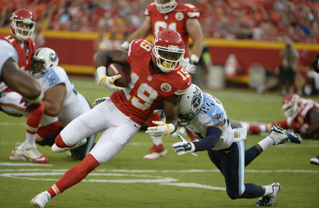 Aug 28, 2015; Kansas City, MO, USA; Kansas City Chiefs wide receiver Jeremy Maclin (19) is tackled by Tennessee Titans cornerback Coty Sensabaugh (24) in the first half at Arrowhead Stadium. Mandatory Credit: John Rieger-USA TODAY Sports